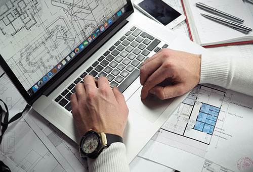 project manager computer and plans